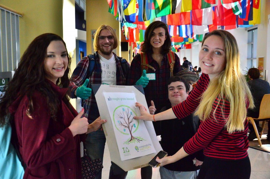 students holding a poster of a tree