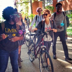 students walking with bicycles